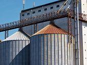 stock photo of silos  - Farm grain silo agriculture industrial production image - JPG