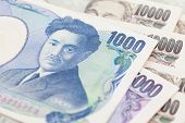 stock photo of japanese coin  - Stack of japanese currency yen or Japanese banknotes - JPG