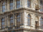 pic of scaffold  - Fragment of scaffolding against house wall in Prague