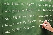 picture of respect  - Text written on chalkboard I will respect my planet Focus is on first sentence - JPG