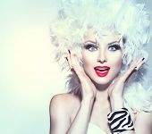 stock photo of wig  - Funny Surprised Woman in white feather wig - JPG