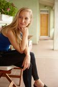 image of daydreaming  - Daydreaming young woman sitting on balcony - JPG