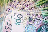 foto of zloty  - One Hundred Polish Zloty Bills Closeup Photo. Polish Currency. ** Note: Visible grain at 100%, best at smaller sizes - JPG