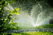 stock photo of sprinkler  - Rotating Lawn Sprinkler - JPG