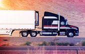 picture of semi trailer  - Speeding Semi Truck on a Highway - JPG