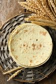 picture of whole-wheat  - Stack of homemade whole wheat flour tortilla on wicker mat - JPG