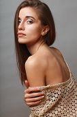picture of low-necked  - beautiful fashion model closeup portrait over gray background - JPG