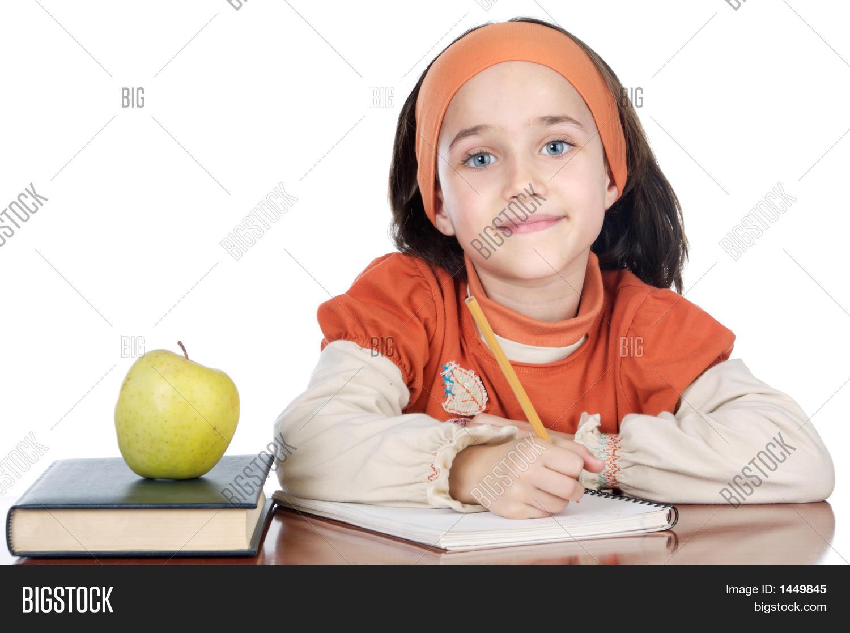 Adorable niña estudiando Fotos stock e Imágenes stock | Bigstock