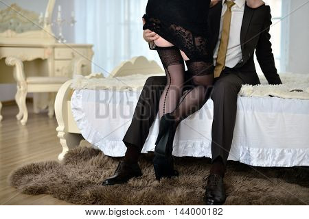 Beautiful Lady In Dress With Guy In Suit. Young Couple Is Hugging Each Other. Portrait Of Girl With