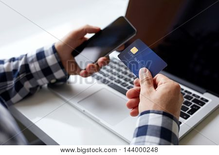 Man With Credit Card And Mobile Phone When Paying Online