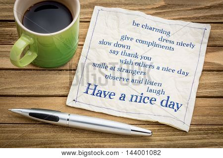 How to have a nice day concept - handwriting on a napkin with a cup of espresso coffee