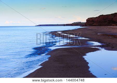 Prince Edward Island beach at dusk.
