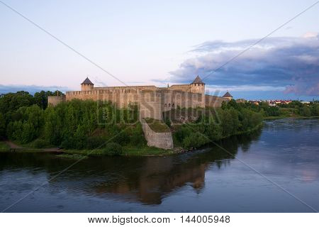 View of the Ivangorod fortress in the summer twilight. Leningrad region, Russia