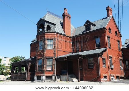ancient red brick house in New England city