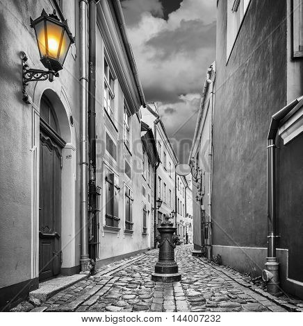 Narrow street in old Riga that is famous tourist city in Baltic region where everyone can feel unforgettable atmosphere of Middle Ages and unique Gothic architecture of the Latvian capital