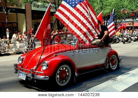 New York City - May 22 2009: Customized Volkswagen car with riders carrying large Turkish and American flags at the Turkish Day Parade on Madison Avenue