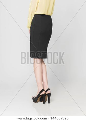 a beautiful model wearing feminine clothes in clear background