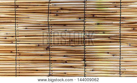 dry straw mat pattern outdoor macro closeup