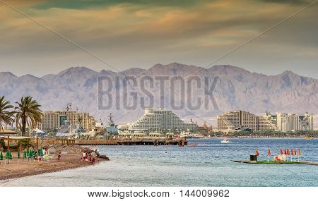 Eilat is a famous Israeli city with beautiful beaches and resort hotels packed with thousands of vacationers and relaxing tourists from around the world