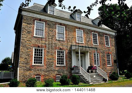 New York City - July 29 2014: South front of Georgian 1748 Van Cortlandt Manor House built in dressed fieldstone with a double-hipped roof  *