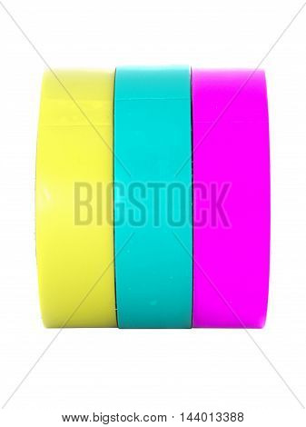 Yellow cyan magenta insulation tape rolls isolated on white background
