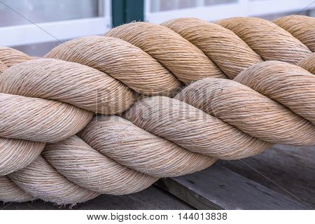 Segments Of Raw Old Rope On The Floor