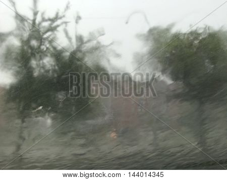 Storm with extreme wind, hail, and lightning watched from a vehicle - buildings and street were unidentifyable