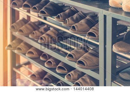 Slippers Or Casual Shoes On Rack In Room
