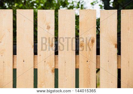 Fragment Of New Wooden Fence In Garden