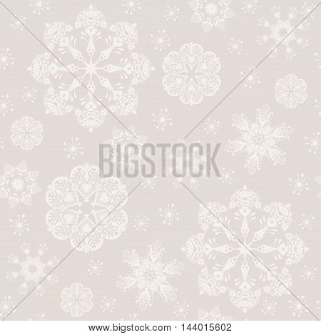 Vintage seamless background ornamenral snowflakes. Vector snow pattern