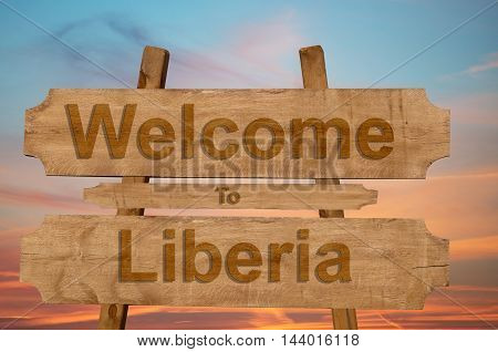 Welcome To Liberia Sign On Wood Background