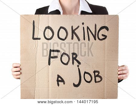 Businesswoman holding sign Looking for a job in white background