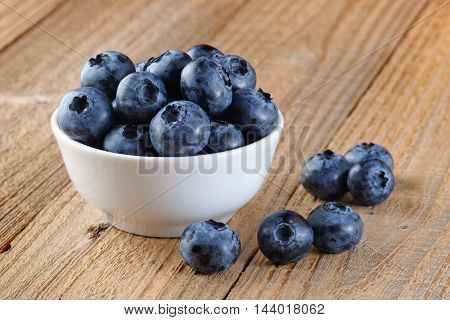 Blueberry in bowl on old wooden table