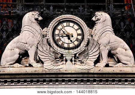 New York City - September 7 2013: Art deco lions flank clock on the south front of the landmark Apple Savings Bank at Broadway and West 73rd Street