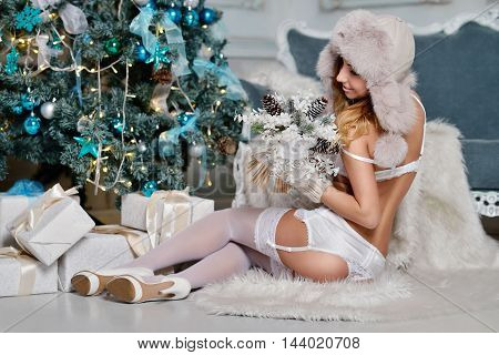 Beautiful Sexy Santa Clause In Elegant Panties, Hat And Bra. Fashion Portrait Of Model Girl Indoors