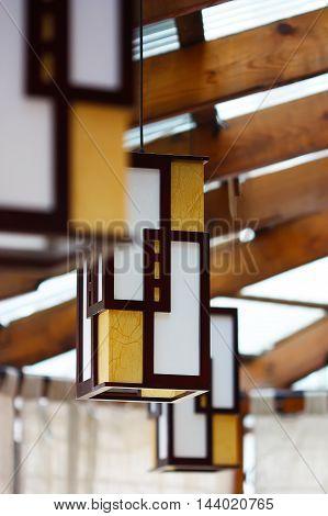 Modern hanging lamp in hotel. Square design