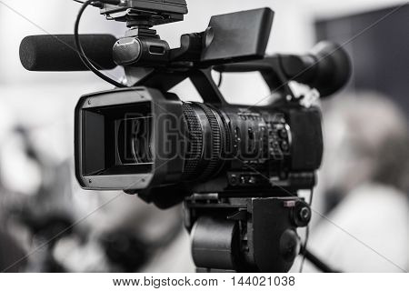 Television Camera, toned image, close up, unrecognizable people