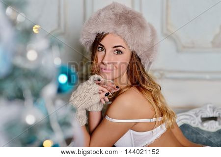 Beautiful Sexy Santa Clause In Elegant Hat And Bra. Fashion Portrait Of Model Girl Indoors With Chri