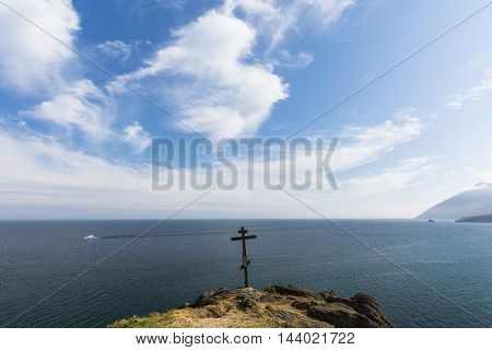 Orthodox cross on a long and high promontory, is the memory of those who perished in the turbulent waters of lake Baikal.