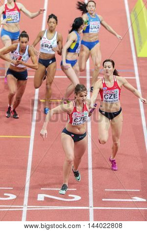 PRAGUE, CZECH REPUBLIC - MARCH 8, 2015: Denisa Rosolova (Czech Republic) and Helena Jiranova (Czech Republic) compete in the women's 4x400m relay event of the European Athletics Indoor Championship.