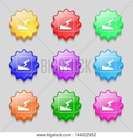 Skier Icon Sign. Symbol On Nine Wavy Colourful Buttons. Vector