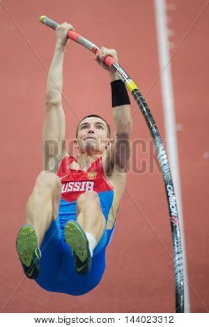 PRAGUE, CZECH REPUBLIC - MARCH 8, 2015: Ilya Shkurenyov (#302 Russia) competes in the men's pole vault event of the European Athletics Indoor Championship.