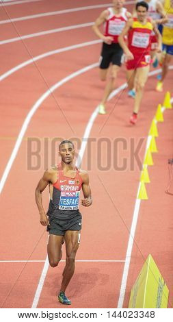 PRAGUE, CZECH REPUBLIC - MARCH 7, 2015: Homiyu Tesfaye (#179 Germany) compets in the men's 1500m event of the European Athletics Indoor Championship.