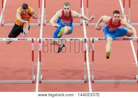 PRAGUE, CZECH REPUBLIC - MARCH 8, 2015: Ilya Shkurenyov (#302 Russia) competes in the men's 60m hurdles event of the European Athletics Indoor Championship.