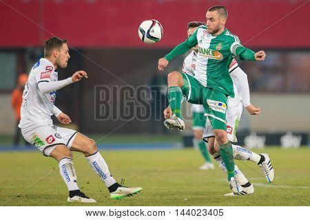 VIENNA, AUSTRIA - FEBRUARY 28, 2015: Anel Hadzic (#8 Sturm Graz) and Steffen Hofmann (#11 Rapid) fight for the ball in an Austrian football league game.