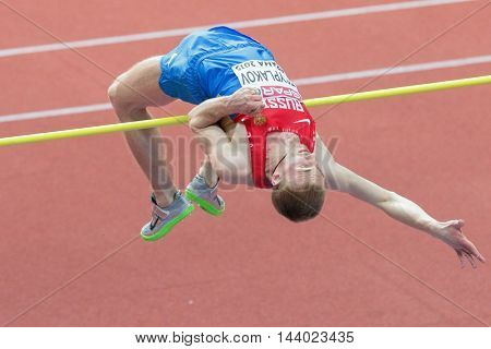 PRAGUE, CZECH REPUBLIC - MARCH 8, 2015: Daniyll Tsyplakov (#316 Russia) competes in the men's high jump event of the European Athletics Indoor Championship.