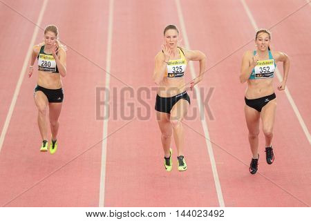 LINZ, AUSTRIA - FEBRUARY 21, 2015: Valerie Kleiser (#325 Austria) competes in the women's 60m event in an indoor track and field event.