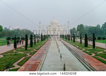 Agra, India - January 8, 2012: The Taj Mahal in the morning fog. Ivory-white marble mausoleum on the south bank of the Yamuna river in the Indian city of Agra Uttar Pradesh. India