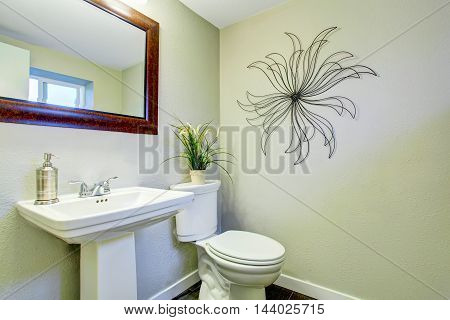 Simple Bathroom Interior With White Sink, Mirror And Toilet.