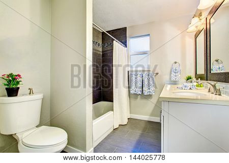 Simple Bathroom Interior With Two Sinks, Mirror And Tile Floor